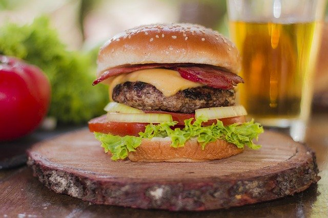 A close up of a burger sitting on top of a table